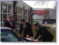 The British Ambassador to Germany, Simon McDonald, signs a unique trade agreement at Hannover Messe 2013