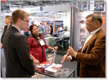 Precision Ceramics Sales Executive, Ben Staniforth, chatting to stand visitors at Ceramitec 2012.